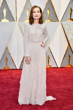 Isabelle Hupert Oscars 2017 Red Carpet: Isabelle in   Armani Privé was absolutley awsame and beautiful. White dress with long sleeves was great choise. She was beautiful in this dress. Silver details on the dress was great. And it looks more glamour and luxury. She is fashionable but this was positive suprise. I fell in love with this dress. She was awsome. Great Isabelle! #oscars2017