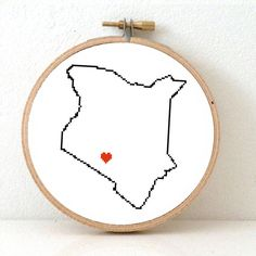 This modern cross stitch pattern features a map of Kenya, with a heart for the capital: Nairobi. Create an original gift for a migrating friend or make