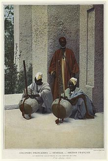 Kora-playing Griots in Senegal, 1900. Both the Kora, a 21-stringed harp-lute, and the griot musical-caste are unique to West Africa.