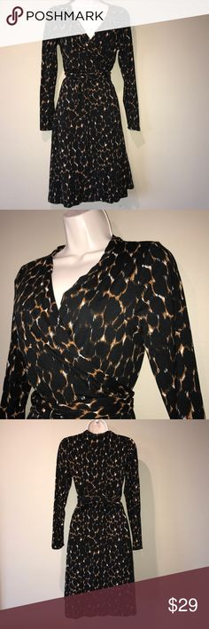 BODEN animal print wrap dress, 12 In excellent preowned condition, cotton stretch animal print wrap dress by Boden.  Long sleeves, size is 12 Boden Dresses Long Sleeve