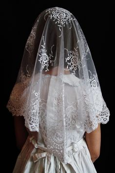Mantillas and chapel veils handcrafted with soft, supple lace and imported mantillas from Spain and Calais, France. Elegance and quality proper for use inside Catholic churches, where the Blessed Sacrament is reserved in the tabernacle.
