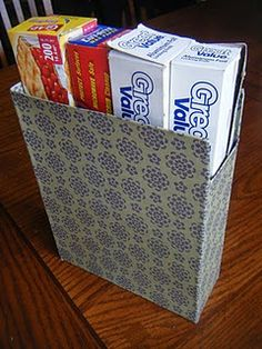 DIY Magazine Holder...Just a cereal box with some Mod Podge to hold the paper on and make the cardboard stronger. Genius!