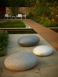 Pico Pebble Seats by Ben Barrell - Made with cast concrete using recycled Cornish Granite. Available in Chalk White, Black Marble or Granite. Uniquely polished to look and feel like natural stone.
