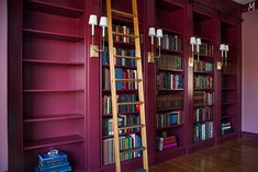 filling the bookshelves in a beautiful home library