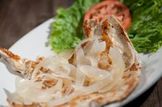 Bistec de Pollo a la Plancha - Fresh boneless chicken breast seasoned with our blend of special spices and grilled to perfection. Topped with fresh sautéed onions.