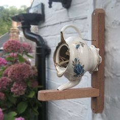 bird house made from a teapot..cute idea for teapot missing it's lid!
