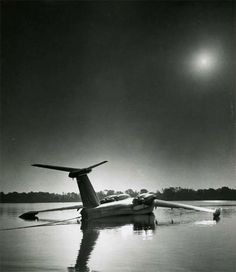 Martin XP6M-1 SeaMaster, circa 1955, sitting quietly, tied to shore, in a low sun.