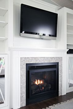 DIY Fireplace Built-In Tutorial by IHeart Organizing: So modern and trendy! See how they did it, and used Zinsser Smart Prime! Find out more about this next-generation, zero-VOC, water-based formula that is the one primer you need for every professional or DIY project. http://www.rustoleum.com/product-catalog/consumer-brands/zinsser/primer-sealers/smart-prime/