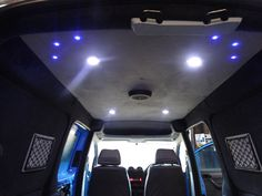 vw caddy with alcantara custom headlining inc led lighting, we have also carpeted the walls in anthracite carpet and added pioneer speakers and storage nets. Vw Caddy Maxi, Campervan Interior, Camper Conversion, Camper Van, Volkswagen, Speakers, Evolution, Carpet, Vans