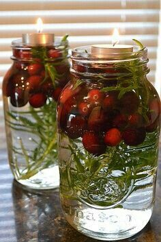 Simple and pretty! Simply take a mason jar, fill it with water and add cranberries and tree trimmings. Top it off with a tea candle and you have a elegant Christmas decoration that will impress your guests!!