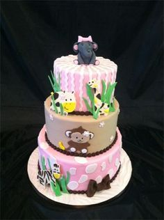 Baby shower cake complete with giraffe, monkey, hippo and elephant