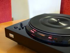 Piano black Sansui Direct Drive Turntable.