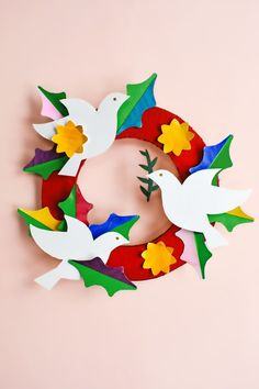 Use watercolor washes on our free templates to create this lovely handmade peace and love DIY paper wreath. Free templates via barley & birch Christmas Crafts For Toddlers, Holiday Crafts, Crafts For Kids, Peace Crafts, Book Page Crafts, Paper Crafts Origami, Diy Paper, Geek Crafts, Craft Day