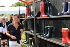 Sophie Countess of Wessex admires the styles on display at the Hunter wellingtons stand
