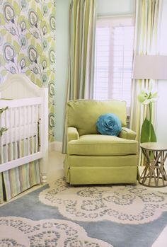 Gender neutral nursery design with gorgeous modern floral green and blue wallpaper accent wall! Traditional style white crib with striped green and blue crib skirt and coordinating draperies. Blue Green Nursery, Blue Crib, Yellow Chevron Rugs, Modern Floral Wallpaper, Nursery Room, Child's Room, Nursery Ideas, Passementerie, Little Girl Rooms
