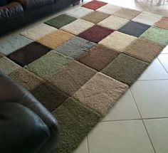 She did this with free carpet square samples and gorilla tape! $12 later-->boom DIY area rug. Different but cool!