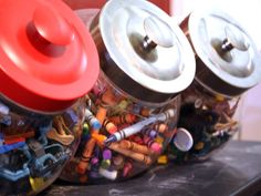 Candy jars as extra storage for art supplies like crayons. Decor and storage! Win!
