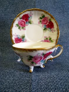 Vintage Tea Cup and Saucer, Fine China with Three Legs and Red Roses, Royal Sealy. $11.99, via Etsy.
