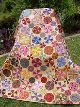 Another lovely circular, colorful quilt