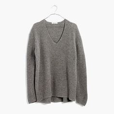 Slouchy and relaxed, this easy pullover is lightweight enough to wear as a shirt (the open V-neck is just right for flashing collarbones). Try it half-tucked into high-rise jeans. <ul><li>Merino wool.</li><li>Hand wash.</li><li>Import.</li></ul>