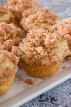 Recipe for Mini Coffee Cake Muffins - these taste just like Coffee Cake but in muffin form. You'll love the delicious cinnamon sugar crumble on top too! Recipe makes 16 mini muffins.