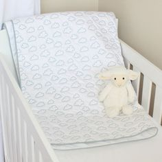 This beautiful 300 thread count quilted cotton playmat has a rich satin stitch embroidery of duck egg clouds. The blanket is perfect as a quilt or a playmat for tummy time. Because it's made from cotton it's gentle on your little one's skin a. Tummy Time, Satin Stitch, Cotton Quilts, Embroidery Stitches, Toddler Bed, Kids Rugs, Clouds, Blanket, Egg