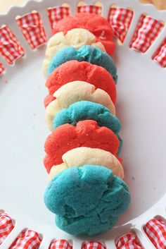 Patriotic Jello Cookies from Munchkin Munchies. What a tasty, fun treat these would be to pack up for a Memorial Day picnic, a 4th of July barbecue, or to pay tribute to Old Glory on  Flag Day. The Jello not only gives them color, but sweet berry flavors as well.