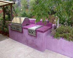 Wow! Just adore this purple outdoor kitchen area. So much personality - it makes the whole entertaining area feel so inviting. By Equinox Landscape in Petaluma, CA.