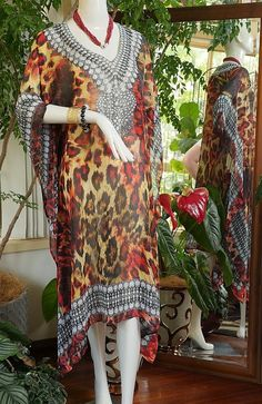 Fab crystal embellished Kaftans 50% off    Mid length Kaftans with fab crystal embellishment on sale now. One size fits most. Can be let out easily as there is a generous side allowance    DON'T MISS OUT ... LIMITED AVAILABILITY    #blackfriday #cybermonday#bling#kaftans#beach#cruising#summer #christmas #instagift #holidays #gift    ACCESSORIES NOT INCLUDED. Can by purchased by emailingsales@glamystique.com for details | Shop this product here: http://spreesy.com/Glamystique/4…
