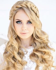 Beach wedding long curly hairstyle with braid detail