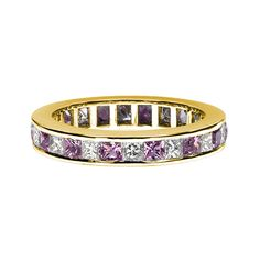A pink sapphire and diamond full eternity ring, alternately set with square cut pink sapphires, combined weight 1.30-1.60 cts*, and princess cut diamonds, combined weight 0.95-1.15 cts*, mounted in an 18ct yellow gold channel setting, bandwidth 3.5mm. * Ring size dependant