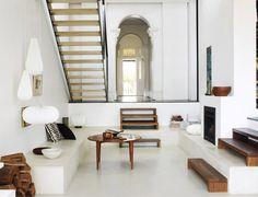 Sunken living room and arch entryway. #livingroom