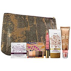 New at Sephora :- Glow Beyond Best–Sellers Set & Travel Bag 49.00 - Brazilliance Skin Rejuvenating Maracuja Self-tanning Face Towelette  - 0.2 oz Beauty & the Box Amazonian Clay Eyeshadow Quad in Just Deserts  - 0.04 oz LipSurgence™ Power Pigment in Awakening  - Travel size Brazilliance™ Skin Rejuvenating Maracuja Self Tanner  - 0.9 oz Bronze & Glow™ Matte Bronzer & Cheek Tint in Park Ave Princess™  - Collector's travel makeup bag