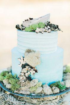 ocean wedding cake - photo by RomaBea Images http://ruffledblog.com/ocean-elegance-bridal-inspiration #weddingcake #cakes