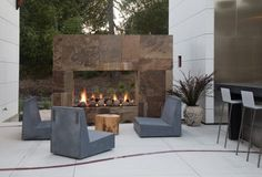 An outdoor fireplace design on your deck, patio or backyard living room instantly makes a perfect place for entertaining, creating a dramatic focal point. Outdoor Stone Fireplaces, Modern Outdoor Fireplace, Outdoor Fireplace Designs, Rustic Fireplaces, Fireplace Ideas, Slate Fireplace, Cozy Fireplace, Terrasse Design, Patio Design