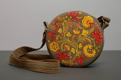Round bag with long strap and painting