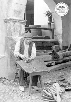 A sole-maker using the traditional bench. 1940s