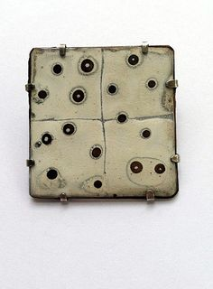 Map Pin by Ken Bova - 2012 -   Brooch: Sterling, torch fired white liquid enamel on copper, 1.75 x 1.75 inches