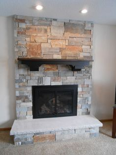 interior black gas fireplace repair with hardwood framing