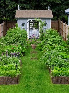 Artsy Garden also pinned in For the Home. 25 ft x 120 ft.  Wood building is prefab shed customized with French doors.  Antique mirrors are trompe l'oiel windows.