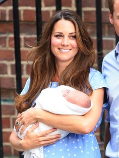 Prince William and Kate Middleton with baby