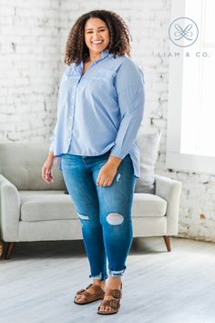 Still on the look out for that perfect button up? We've got you covered with our Kerry Oversized Button Up! Our top features a pinstriped design, oversized fit, two front pockets, a collar, cuffed sleeves, and a long button up fit! With the comfy fabric and roomy fit, what's not to love? We like our top worn with comfy slacks or more casually with a favorite pair of jeans!