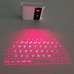 Wireless Laser Projection Keyboard - http://dudebrogifts.com/wireless-laser-projection-keyboard/