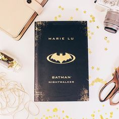 Things Im currently doing? Writing an essay. Things Id rather be doing? Reading Batman: Nightwalker by Marie Lu!  This hardback version is available from @Waterstones and the cover is even more gorgeous in real life. QOTD - What book cover makes you swoon?  . . . . . . . . #marielu #batmannightwalker #capturinglife #dreamy #bookblog #bookstagram #instabook #bookish #ireadya #bookworm #readersofig #flatlay #fiction #asthetics #ukya #batman #acolorfullife #postitfortheasthetic #bookoftheday…