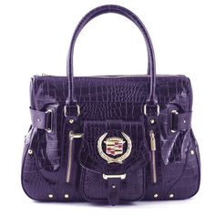 I purchased a simular Cadillac purse mine is Black and Tan. Didn't even know they had bags!