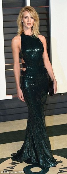 Rosie Huntington-Whiteley in an Alexandre Vauthier dress, which boasted a small trail and cut-out detailing on the back, highlighting her lean and slender frame to perfection.