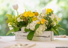 White and yellow table arrangement (centerpiece) with tulips, hydrangea, goldenrod, mums, waxflower and spray roses. Southern Events