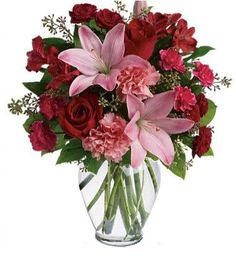SOUL STRUCK     If you're looking to bare your soul, express your love, passion, and adoration for your special someone; then send our stylish Soul Struck Bouquet, featuring a romantic gathering of Roses, Asiatic Lilies, Carnations, and Alstromeria in a palette of shimmering soft pinks and vibrant ruby reds accented with fresh seasonal greenery for a charming gift that radiates romance! A perfect gift for celebrating love, anniversaries, or just because!