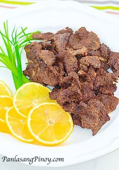 """Beef Tapa is dried cured beef similar to """"Beef Jerky"""". This is traditionally prepared by curing the meat with sea salt and letting it dry directly under the sun for the purpose of preserving the meat."""