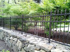 Wrought Iron Fencing with stone.......perfect combo. Ill take two please!